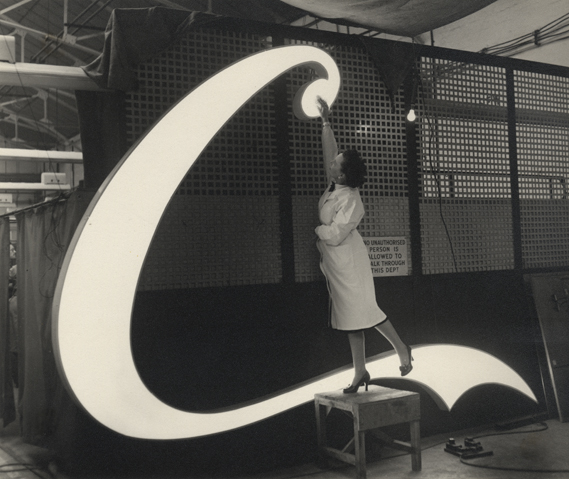 Polishing neon sign, 1954